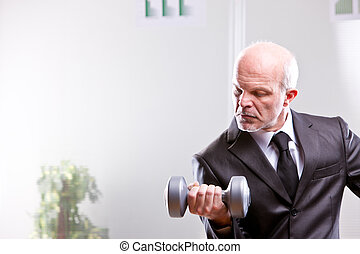 weightlifting business man in action looking at his shot