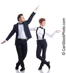 Artistic young businessmen dancing in studio