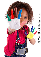 Little African Asian girl with hands painted in colorful...