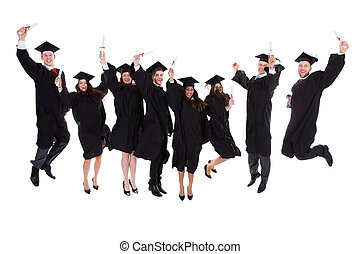 Happy rejoicing group of multiethnic graduates leaping in...