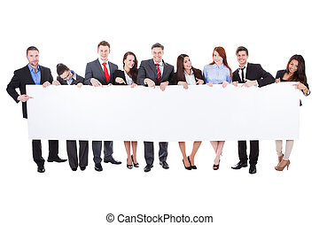 Large group of businesspeople presenting banner - Large...