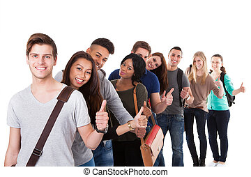 College Students Gesturing Thumbs Up In A Line - Portrait of...