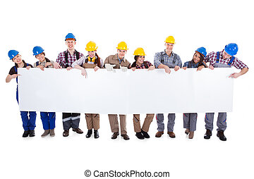 Group of workmen and women with a banner - Large diverse...