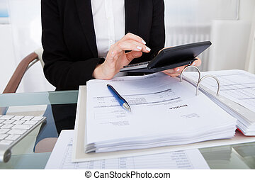 Businesswoman Calculating Bills - Close-up Of Businesswoman...