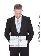 Businessman holding a top secret file - Businessman holding...