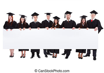 Graduate students holding empty banner Isolated on white