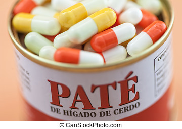 Some pills go out of a canister of pate of pig isolated on...