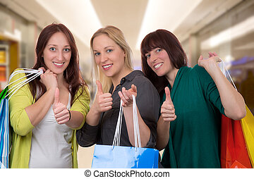 Group of young women with shopping bags in shopping mall