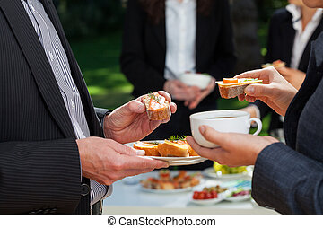 Business lunch in the garden - Business people who are...