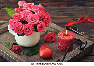 Valentine day concept - Rose bouquet with stone in shape of...