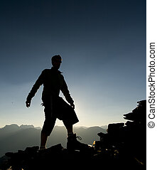 Silhouettes on Mountain at Sunrise