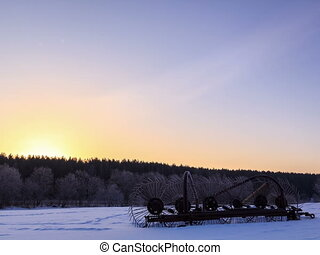 Tractor rake the snow at dawn. Time Lapse.