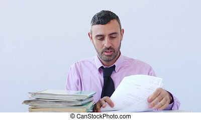 Exhausted businessman asleep at his desk - Exhausted...