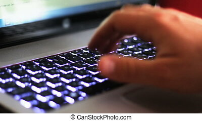 Close up of hands clicking laptop - typing on keyboards with...