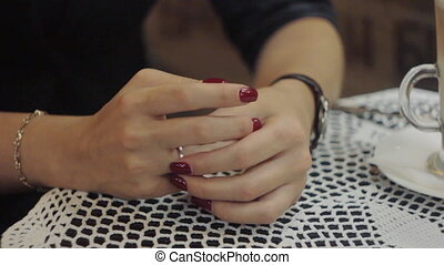 Woman touch her wedding ring, nervous