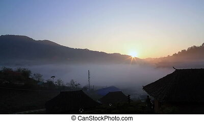 Sunrise behind the mountain - Sunrise at Rak Thai Village,...