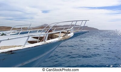Nose yacht - White motor yacht at open sea