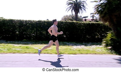 Wide shot of man running on street - Professional runner...