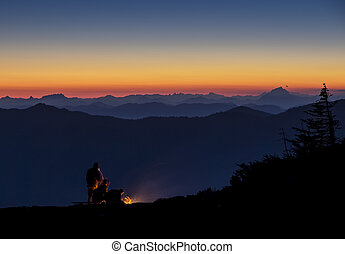 NIght time camping on a mountain top with a beautiful sunset...