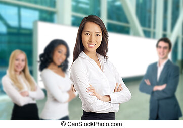 Business women leading her team - formal young women with...