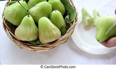 green rose apple on the basket