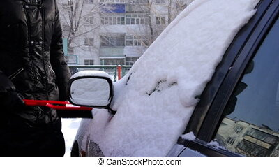 Winter car  - Woman removing snow from her car