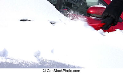 Winter car - removing snow from her car