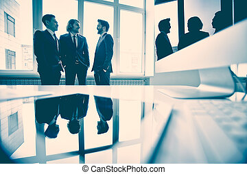 Business discussion - Business partners discussing new...