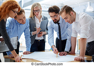 Plan development - Business team developing plan together at...