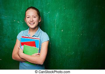 Clever schoolgirl - Portrait of cute schoolgirl with...