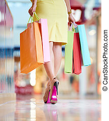 Walking down the mall - Image of shopaholic with shopping...