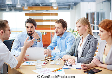 Talk-in - Image of a serious business team at the meeting