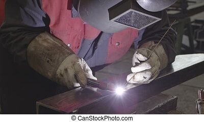 Welder in action Welding a steel edge