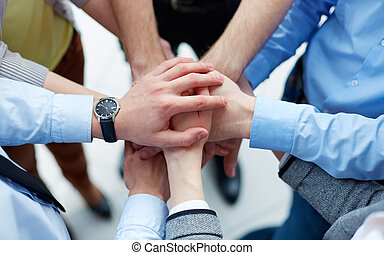 Business agreement - Businesspeople joining their hands in...
