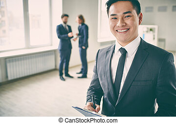 Successful manager - Close-up portrait of a young successful...