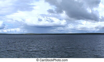 Time Lapse, Lake and Clouds - A time lapse shot of lake and...