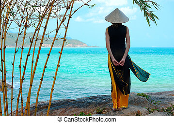Young vietnamese woman in traditional clothing