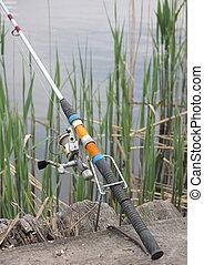Fishing Rod during fishing on lake