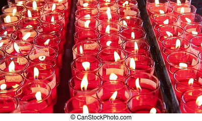 Rows of burning candles