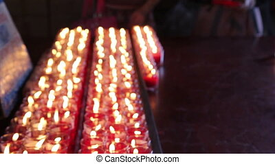 Rows of burning candles at the Chinese temple
