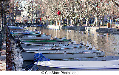 ANNECY, FRANCE : December 25, 2011 : The canal ringed by the beautifully trees in Annecy, France.