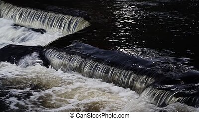 Upper Bond Falls Angle Loop - Water flows over angular rock...