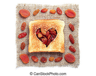 Slice of bread and dried fruit - Slice of bread with cut out...