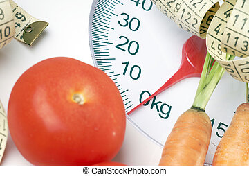 healthy eating - Vegetables with measuring tape on a Body...