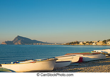 Traditional fishing boats in a very Mediterranean setting,...