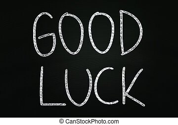 Good Luck writing, written with Chalk on Blackboard
