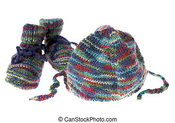Baby Clothes - knitted baby shoes and knitted hat isolated...