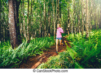 Woman Running in Nature. Trail Running in Forest. Active...