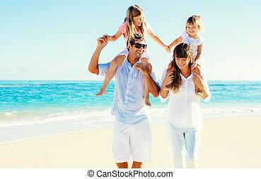 Happy Family at the Beach - Happy Family Having Fun on...
