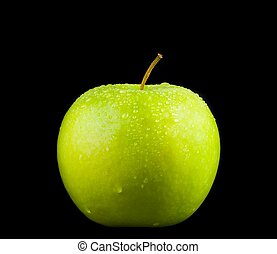fresh green apple with droplets of water against black background